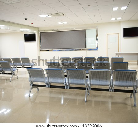 Hospital waiting room with empty chairs. - stock photo