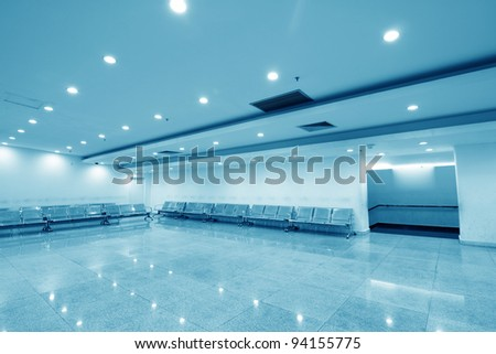 Hospital waiting room with empty chairs - stock photo