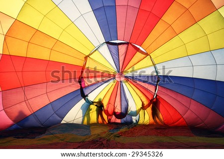 Hot air balloon and silhouette of people