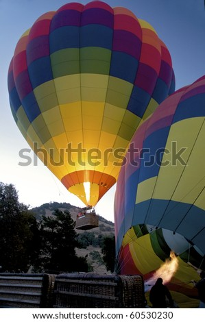 Hot Air Balloon ascending. - stock photo