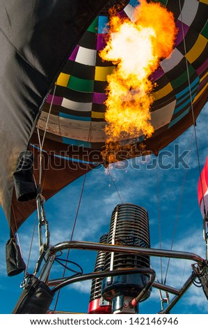 Hot air balloon burners inflating the balloon - stock photo