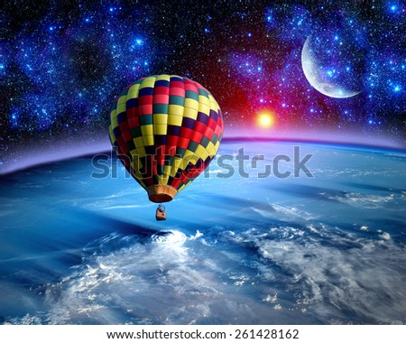 Hot air balloon fairy tale landscape fantasy moon earth. Elements of this image furnished by NASA. - stock photo
