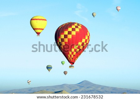Hot air balloon flying over Cappadocia in Turkey. - stock photo