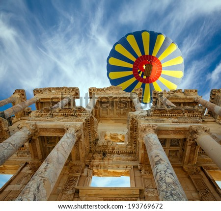 Hot air balloon flying over Celsus Library, Ephesus - stock photo