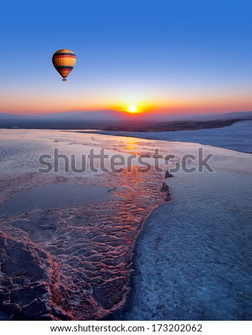 Hot air balloon flying over spectacular pamukkale. Abstract background - stock photo