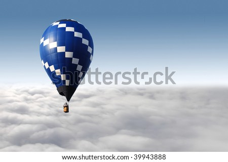 hot air balloon flying over the clouds - stock photo