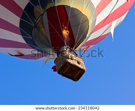 Hot-air balloon flying, unusual perspective view from bottom, detail - stock photo
