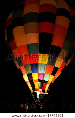 Hot air balloon glowing at night