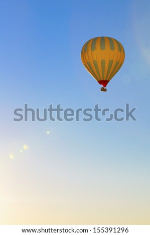 hot air balloon in blue sky - stock photo