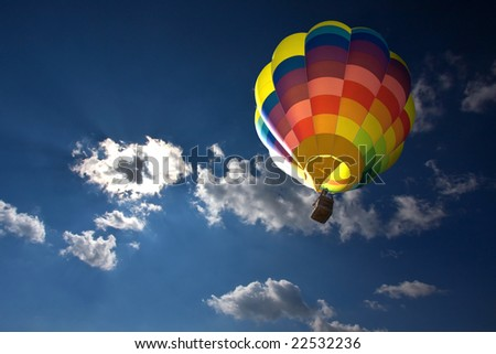 Hot air balloon in the blue sky and clouds - stock photo