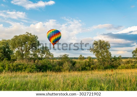 Hot air balloon in the evening sky - stock photo