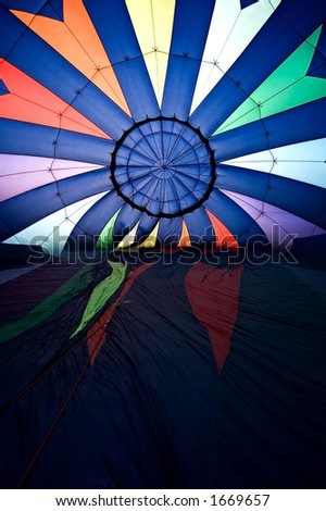 hot air balloon inflating - interior shot with balloon still laying on its side - stock photo