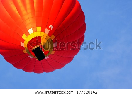 hot air balloon on background blue sky. bottom view - stock photo