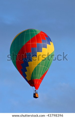 Hot air balloon on sky before landing