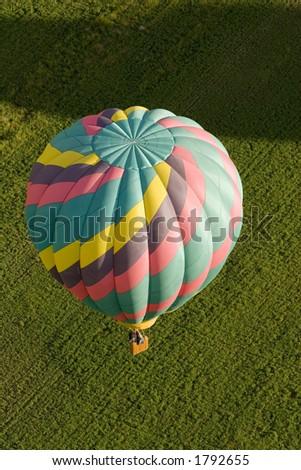 Hot Air Balloon over Fields - stock photo