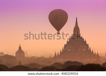 Hot air balloon over misty morning around Temple in Bagan , Myanmar - stock photo