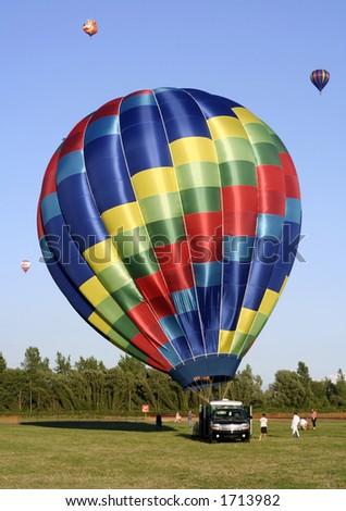 Hot air balloon preparing for launch - stock photo
