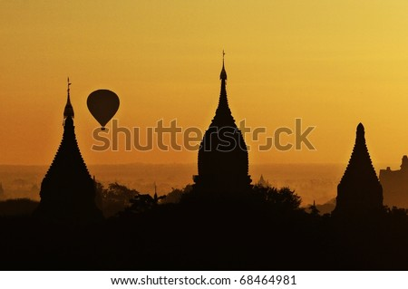 Hot air balloon ride early morning over temples of Bagan Myanmar - stock photo