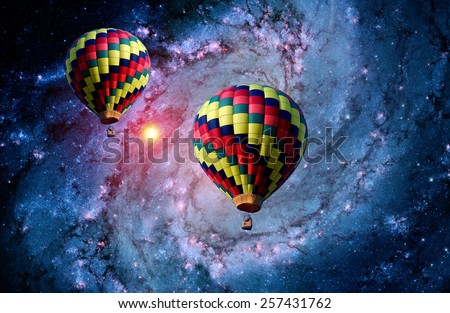 Hot air balloon surreal landscape magical fantasy galaxy. Elements of this image furnished by NASA. - stock photo