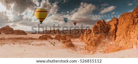 Hot Air Balloon travel over Africa desert