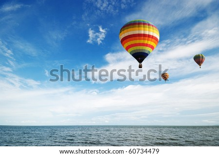 Hot air balloon travel over gulf of Thailand - stock photo