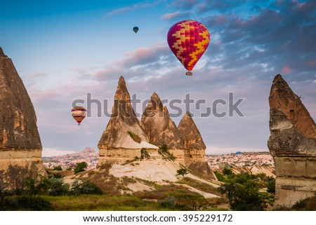 hot air balloon trip flying over Cappadocia - stock photo