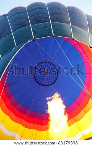 Hot air balloon with burning flame - stock photo