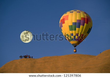 Hot Air balloon With Full Moon. - stock photo