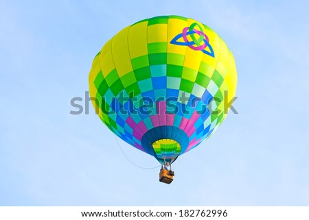 Hot air balloon with heart inside trinity symbol.