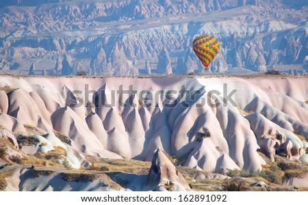 Hot air balloons above gorgeous cappadocia - stock photo