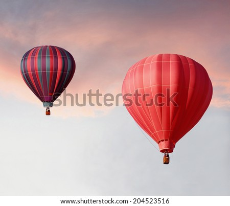 Hot Air Balloons Ascending in a Beautiful Sunset - stock photo