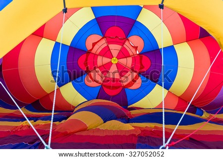 Hot Air Balloons Being Inflated in Early Morning - stock photo