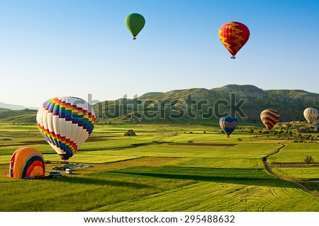 Hot air balloons fly over Cappadocia is known around the world as one of the best places to fly with hot air balloons, Goreme, Cappadocia, Turkey.  - stock photo