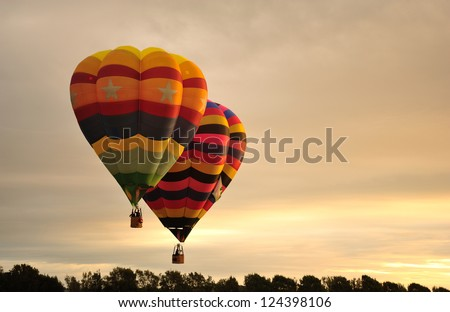 Hot air balloons flying during festival at Levin, New Zealand - stock photo