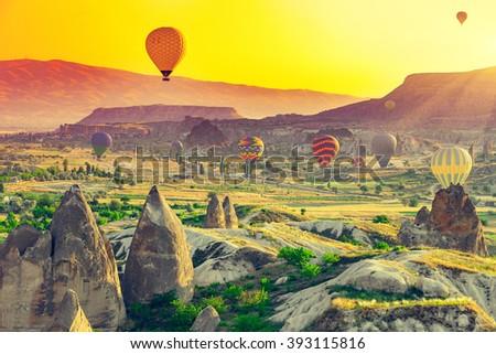 Hot air balloons flying over spectacular Cappadocia - stock photo