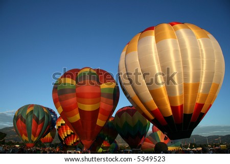 Hot air balloons getting ready - stock photo