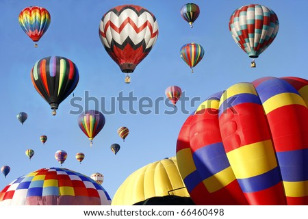 Hot Air Balloons in Mass Ascension - stock photo