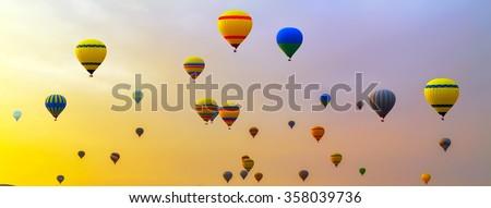 Hot air balloons landing in a mountain Cappadocia Goreme National Park Turkey. - stock photo