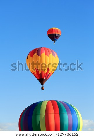hot air balloons over blue sky - stock photo