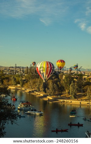 Hot Air Balloons soar over Lake Havasu - stock photo