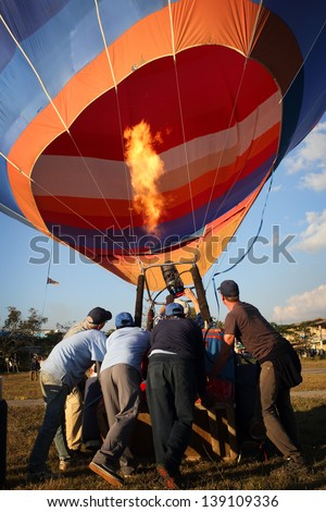 Hot-air balloons take off in Nyaungshwe, Myanmar - stock photo