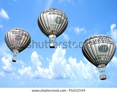 Hot air balloons with 10, 50 and 100 dollar banknotes - stock photo
