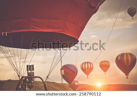 Hot Air Balloons with Sunrise applying Retro Instagram Style Filter - stock photo
