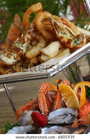 hot and cold seafood on two tier platter at restaurant - stock photo