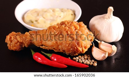 Hot and crispy fried chicken, sauce, chili, garlic and black pepper - stock photo