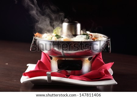 hot and tasty chinese soup with vegetables - stock photo