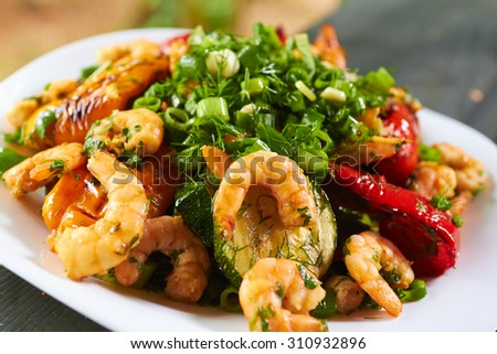 hot appetizer with vegetables and prawns - stock photo