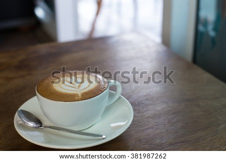 Hot art Latte Coffee in the table. - stock photo