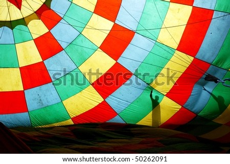 hot balloon texture with the shadows of two men - stock photo