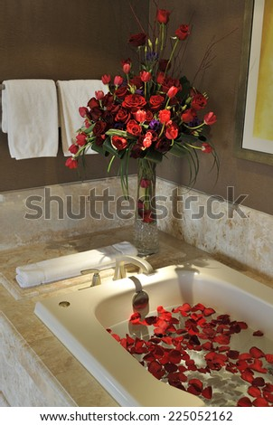 hot bath tub with flower petals - stock photo